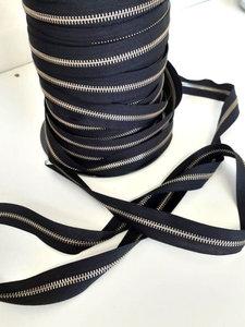 Rolrits metaal zilvertand met zwarte band eindloos